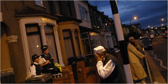 British police officers guarded a house raided earlier in London's Walthamstow District.